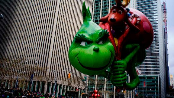 The Grinch balloon looks as mischievous as ever.