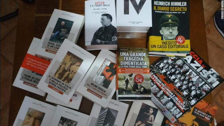 Police searched 19 homes across Italy and found books, plaques and flags  with images of Adolf Hitler and Benito Mussolini.
