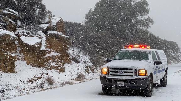 This photo tweeted by the Santa Barbara County Fire Department shows a Santa Barbara Fire Department truck along E. Camino Cielo as snow falls at the 3,500 foot level on the fire footprint in Santa Barbara, California, on Thursday, November 28, 2019