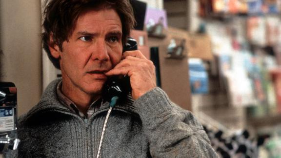 """Harrison Ford talks on a pay phone in a scene from the 1993 film, """"The Fugitive."""""""