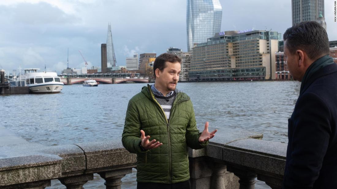 The oceanographer Ivan Haigh speaks to CNN along the River Thames.