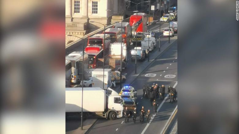 "Jinnat Ui Hasan tells CNN he was in a meeting in a building near London Bridge when he heard ""more than five"" gunshots. He took these photos of the scene after the gunshots."