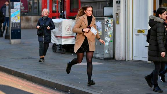 A woman runs from the London Bridge area.