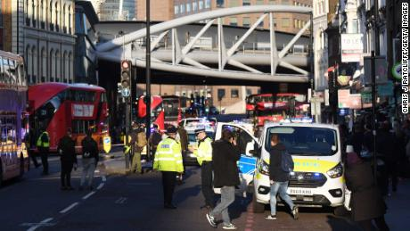 LONDON, ENGLAND - NOVEMBER 29: Traffic is stopped and members of the public are held behind a police cordon near Borough Market after reports of shots being fired on London Bridge on November 29, 2019 in London, England. Police responded to an incident around 2:00 pm local time, followed by reports of gunfire. (Photo by Chris J Ratcliffe/Getty Images)
