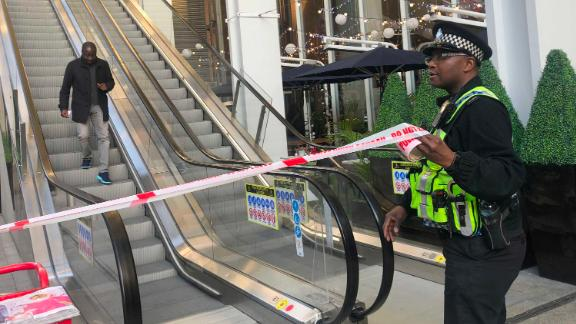 A police officer cordons off the London Bridge Station.