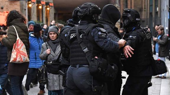 Police search a person near London Bridge on November 29.