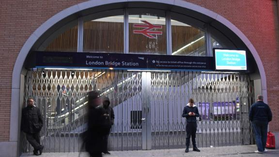 People stand outside the London Bridge Station after it was closed.