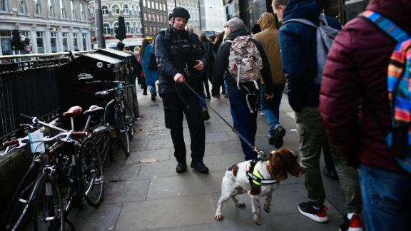 A police officer and dog work near Borough Market.