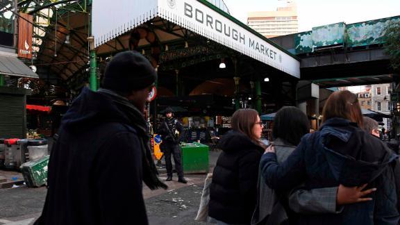 Police evacuate the Borough Market near London Bridge.