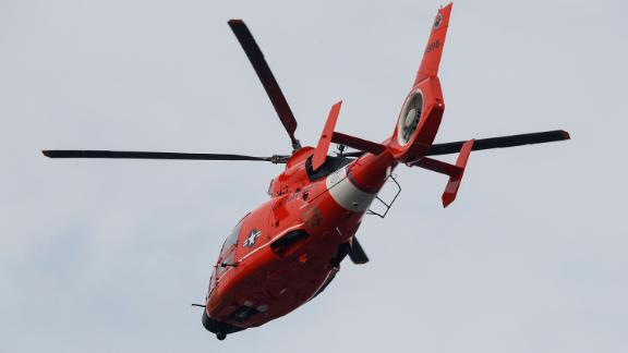 A Coast Guard MH-65D Dolphin helicopter like this one deployed in the search.