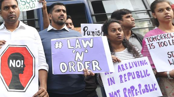 Protesters in New Delhi hold a demonstration on Friday demanding justice after the rape and murder case of the veterinarian in Hyderabad.