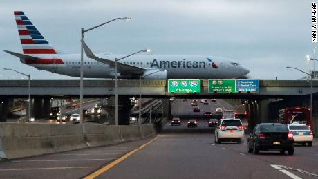 An American Airlines flight arrives at O'Hare airport in Chicago, Wednesday, Nov. 27, 2019. According to the source, the number of people traveling over the Thanksgiving holiday period is forecast to amount to 55.3 million in 2019. (AP Photo/Nam Y. Huh)