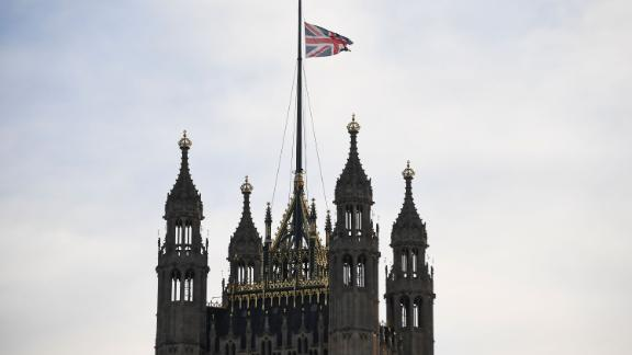 The Union Flag flies at half mast on the Victoria Tower in London.