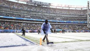 The MetLife Stadium field crew had a busy day shoveling snow at the Packers-Giants game