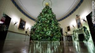 The official White House Christmas tree is decorated in the Blue Room during the 2019 Christmas preview at the White House, Monday, December 2, 2019, in Washington.