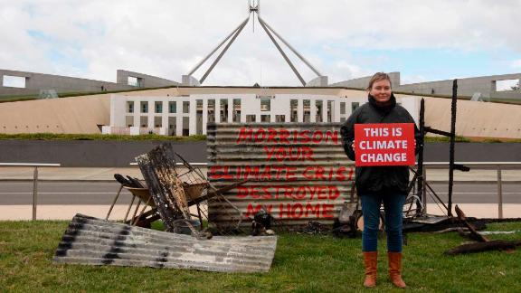 "Bushfire survivor Melinda Plesman delivers the message ""This is Climate Change"" outside Parliament House in Canberra."