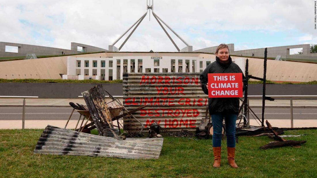 Woman dumps remains of her bushfire-ravaged home outside Australian parliament to protest climate change