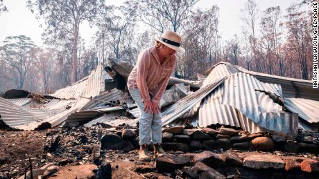 Plesman examines her property, which was destroyed by bushfires in Nymboida, New South Wales.