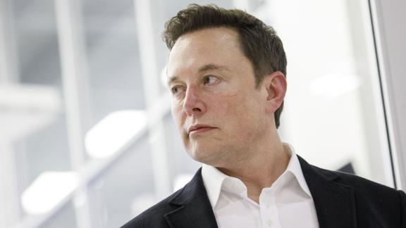 Elon Musk, chief executive officer of Space Exploration Technologies Corp. (SpaceX) and Tesla Inc., listens as Jim Bridenstine, administrator of the U.S. National Aeronautics and Space Administration (NASA), not pictured, speaks during an event at SpaceX headquarters in Hawthorne, California, U.S., on Thursday, Oct. 10, 2019. SpaceXs Elon Musk and NASA Administrator Jim Bridenstine staged a public show of support for one another at the rocket companys headquarters Thursday, weeks after the two traded barbs over the closely held companys delayed efforts to fly astronauts for the first time. Photographer: Patrick T. Fallon/Bloomberg via Getty Images