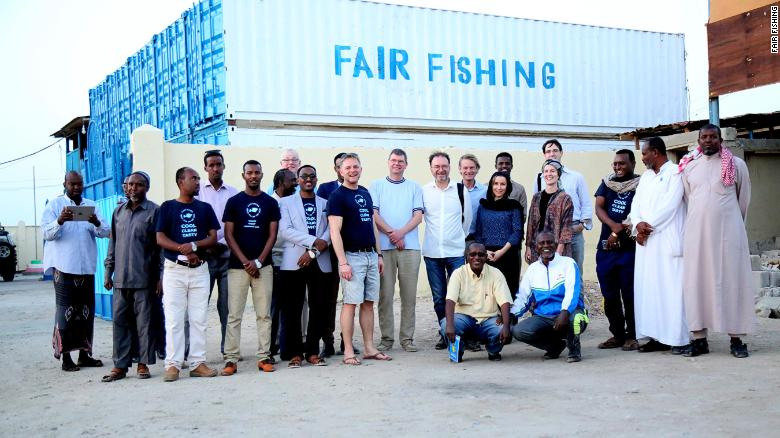 Some of the FairFishing staff, including local management, board members and fishers, gathered outside the fish station in Berbera, Somaliland.