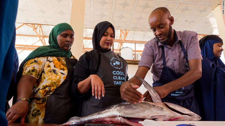 A FairFishing chef, Suleiman Farah, at a 'Fresh Fish on the Dish' training, where female householders, chefs and fish mongers learn how to handle and prepare fish.