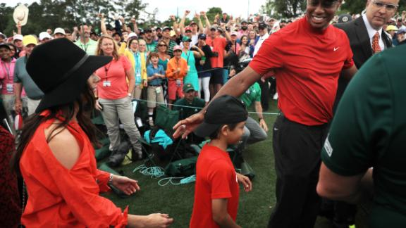 Tiger Woods celebrates with his son Charlie after winning his fifth Masters title.