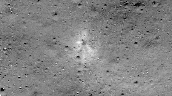 Dark streaks and a bright halo highlight the impact zone.