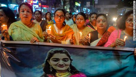 Supporters of India's ruling Bharatiya Janata Party (BJP) hold a vigil for the Hyderabad rape and murder victim in Siliguri, West Bengal on November 30, 2019.