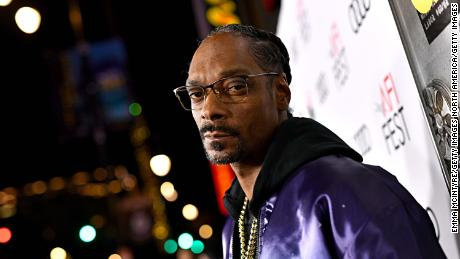 Snoop Dogg has got his mind on his money and his money on some wine.
