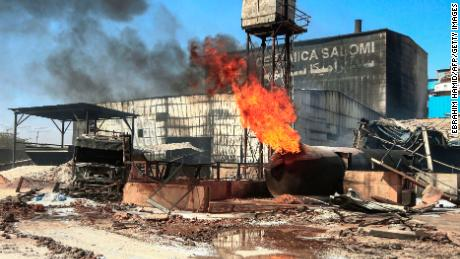 A burning gas tank at the scene of the fire at an industrial zone in Sudan's north Khartoum on Tuesday.