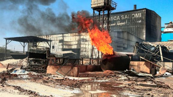 A burning gas tank at the scene of the fire at an industrial zone in Sudan