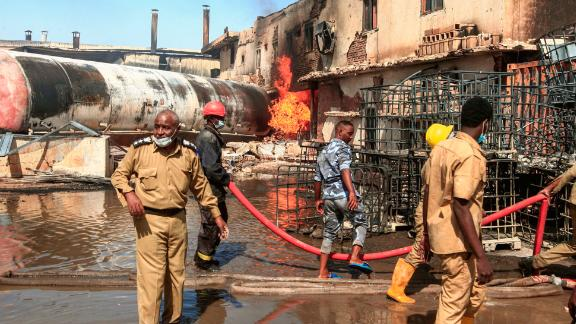 Members of the Sudanese Civil Defense put out the fire at a factory unit in northern Khartoum.
