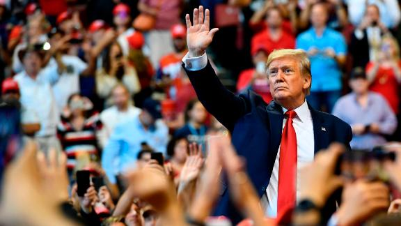 """TOPSHOT - US President Donald Trump waves to supporters during a """"Keep America Great"""" campaign rally at the BB&T Center in Sunrise, Florida on November 26, 2019. (Photo by MANDEL NGAN / AFP) (Photo by MANDEL NGAN/AFP via Getty Images)"""