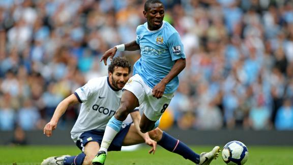 Wright-Phillips goes past the tackle from Carlos Cuellar of Aston Villa.