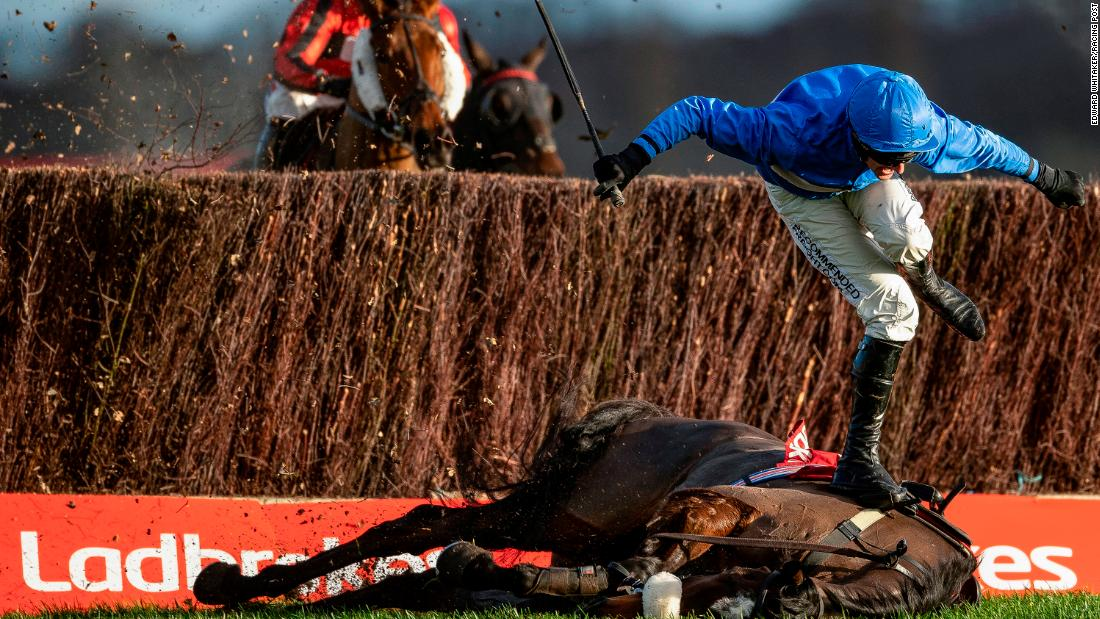 """Although it's unfortunate, falling jockeys make good photographs. He is making such a great shape, like a dancer,"" Whitaker said, confirming that both horse and jockey were safe after the fall."