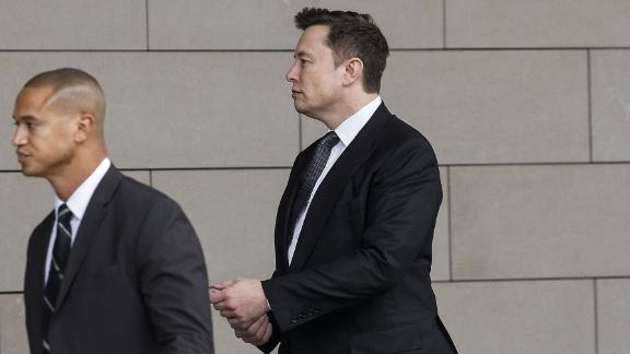 "Elon Musk, chief executive officer of Tesla Inc., arrives at federal court in Los Angeles, California, U.S., on Tuesday, Dec. 3, 2019. Musk will have to go before a federal jury and defend calling a British caver a ""pedo guy."" Photographer:"