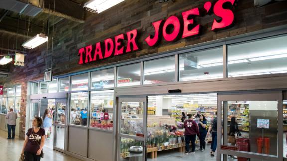 A shopper walks past a Trader Joe