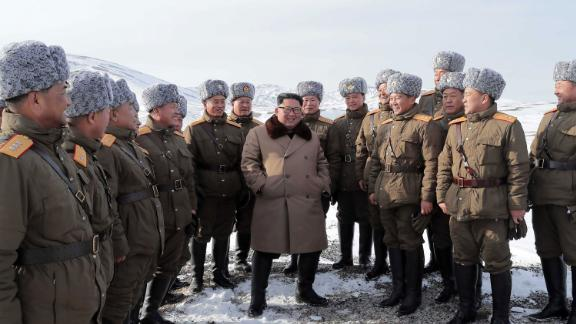 This undated picture released from North Korea's official Korean Central News Agency (KCNA) on December 4, 2019 shows North Korean leader Kim Jong Un (C) visiting battle sites at Mount Paektu, Ryanggang.
