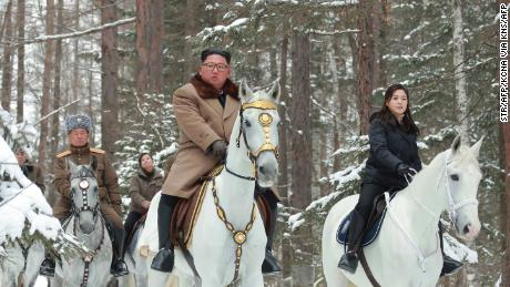 This undated photo released by North Korea's official Korean Central News Agency Wednesday shows North Korean leader Kim Jong Un (center), his wife Ri Sol Ju (right, in black) and Pak Jong Chon (left, in the grey hat) visiting Mount Paketu.