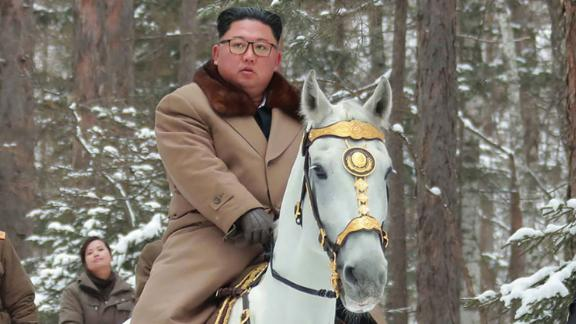 This undated picture released from North Korea's official Korean Central News Agency (KCNA) on December 4, 2019 shows North Korean leader Kim Jong Un (C) riding a horse as he visits battle sites at Mount Paektu, Ryanggang.