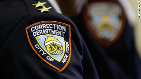 Corrections officers listen to a news conference in an enhanced supervision housing unit on Rikers Island in New York on March 12, 2015.