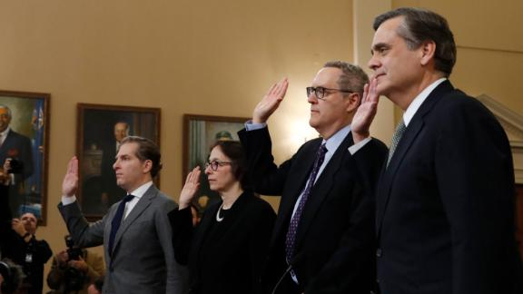From left, Constitutional law experts, Harvard Law School professor Noah Feldman, Stanford Law School professor Pamela Karlan, University of North Carolina Law School professor Michael Gerhardt and George Washington University Law School professor Jonathan Turley are sworn in before testifying during a hearing before the House Judiciary Committee on the constitutional groun