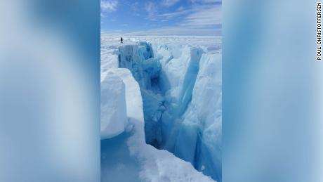 """After draining, lakes leave behind holes called """"moulins,"""" which allow meltwater to continue to travel to the bottom of the ice sheet."""