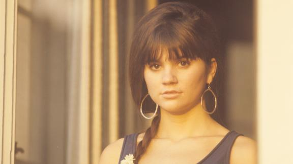 """Ronstadt briefly enrolled at the University of Arizona in 1964 but dropped out to pursue a singing career in California. Bobby Kimmel, a musician who played bass in her siblings' band, introduced her to a guitarist named Kenny Edwards. The trio formed the folk group the Stone Poneys and began booking gigs after playing an open mic night at <a href=""""http://www.cnn.com/travel/article/us-music-venues/index.html"""" target=""""_blank"""">L.A.'s famous Troubadour venue.</a>"""