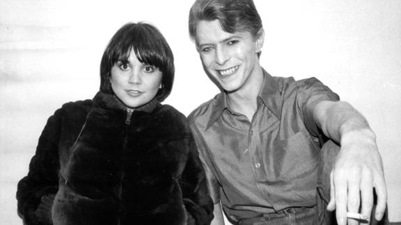 """At the dawn of the 1980s, Ronstadt was at the top of her game. """"Linda was the queen,"""" Bonnie Raitt says in CNN Films' documentary on the singer. """"She was like what Beyonce is now."""" Ronstadt is pictured here backstage with David Bowie in 1980."""