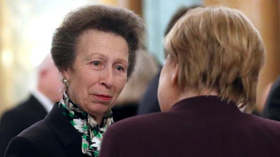 Princess Anne speaking to German Chancellor Angela Merkel at Buckingham Palace on Tuesday night.