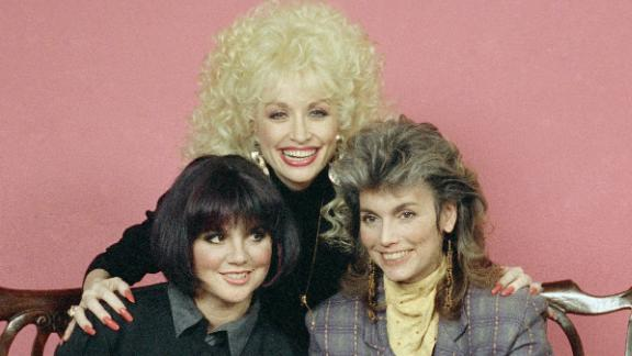 """Ronstadt had known country superstars Dolly Parton and Emmylou Harris (center and right) for years by the time the three decided to release the album """"Trio."""" The record, which arrived in 1987, went platinum; gave the stars another No. 1 with """"To Know Him Is To Love Him""""; and won a Grammy for best country performance by a duo or a group."""