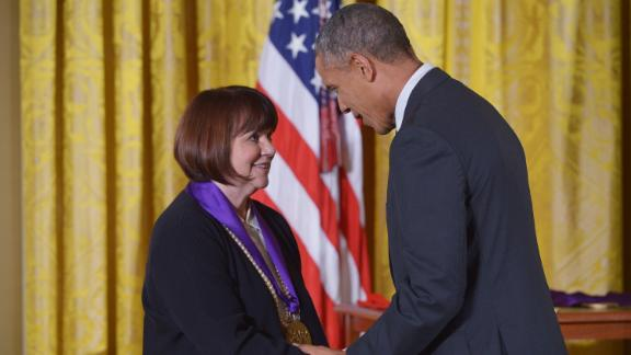 President Barack Obama presents the National Medal of Arts to Linda Ronstadt at the White House on July 28, 2014.