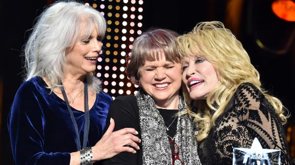 """Today, Ronstadt, who has two children, lives in the Bay Area with her son, according to the <a href=""""https://www.latimes.com/entertainment-arts/movies/story/2019-09-04/linda-ronstadt-documentary-the-sound-of-her-life"""" target=""""_blank"""" target=""""_blank"""">Los Angeles Times</a>.<br /><br />While she sometimes still appears in the spotlight -- as she did earlier this year, when she and Emmylou Harris (left) presented Dolly Parton with the 2019 MusiCares Person of the Year award -- she mostly sticks close to home, she told the Times.<br /><br />""""There's nothing I can do about it. It's going to get worse every day,"""" Ronstadt said of her diagnosis. """"I feel frustrated with it. ....  Sometimes I fall down. But that's the new normal. I just have to accept it. I had a long turn at the trough."""""""