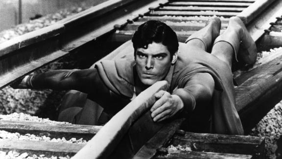 "Christopher Reeve plays the hero as he mends a broken railway track in a scene from ""Superman."""